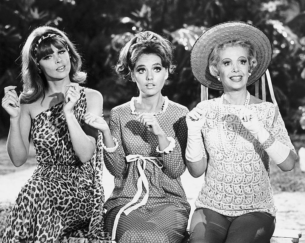 Image Source: Getty Images/Bettmann/Ginger (Tina Louise), girl-next-door Mary Ann (Dawn Wells), and millionairess Mrs. Howell (Natalie Schaefer) in a scene from the 1960s television comedy Gilligan's Island