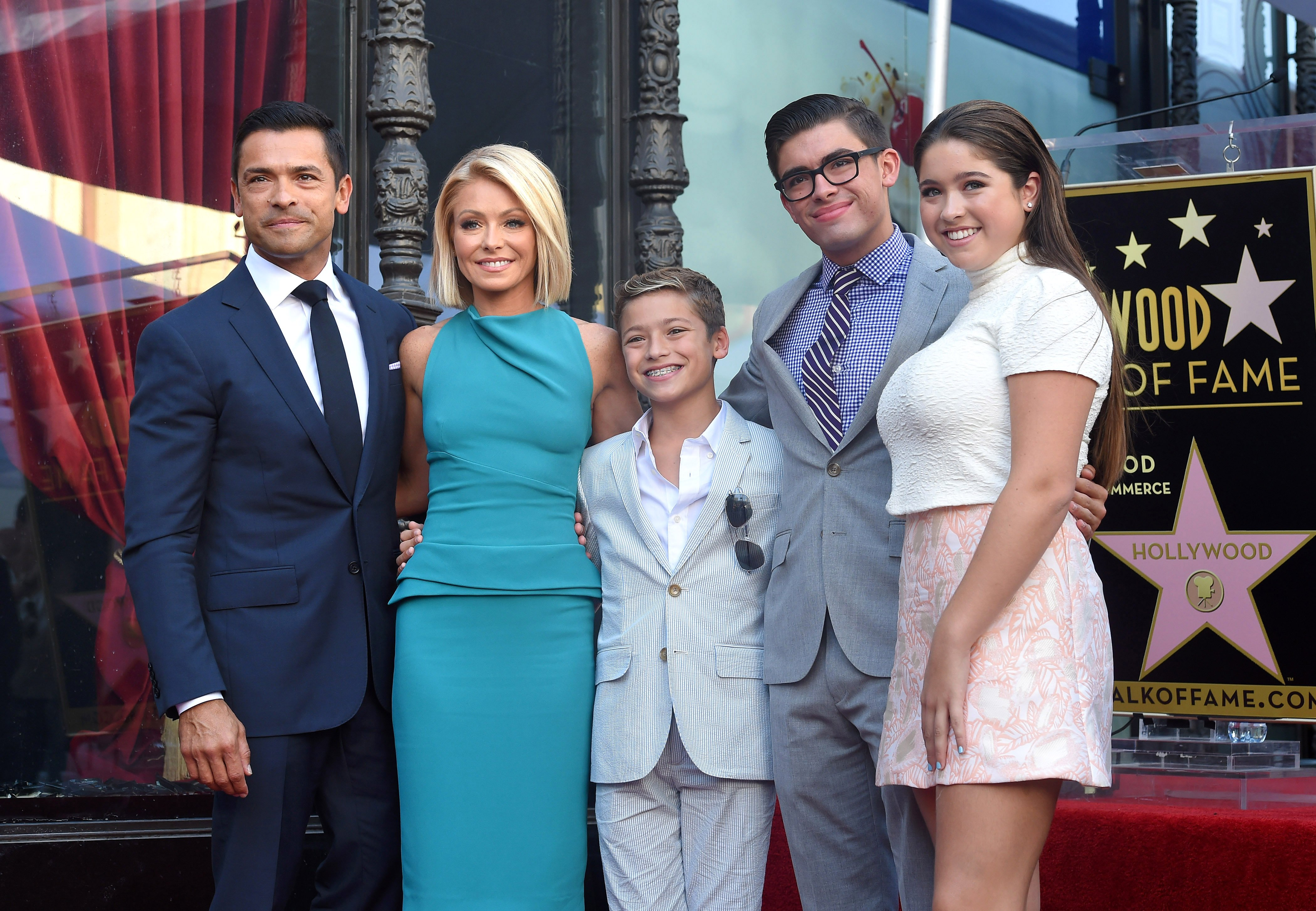 Image Credits: Getty Images / Axelle / Bauer-Griffin / FilmMagic | Kelly Ripa, husband Mark Consuelos, daughter Lola Consuelos, sons Michael Consuelos and Joaquin Consuelos attend the ceremony honoring Kelly Ripa with a star on the Hollywood Walk of Fame on October 12, 2015 in Hollywood, California.