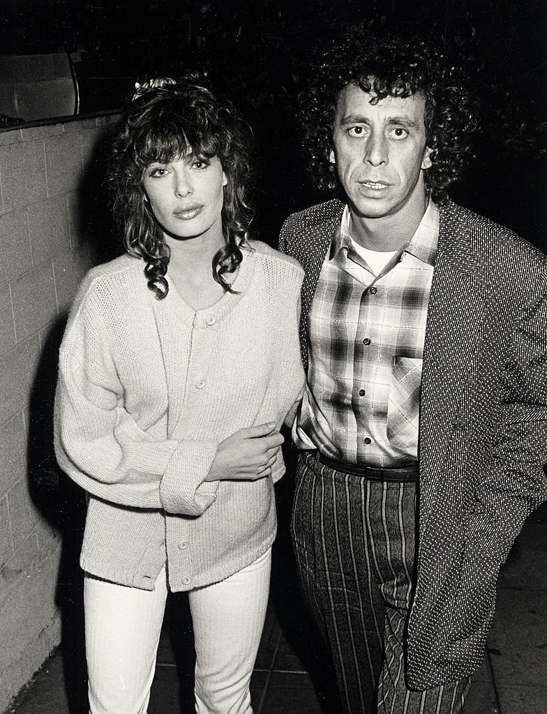 Image Credits: Getty Images / Ron Galella, Ltd. / Ron Galella Collection | Model Kelly LeBrock and husband Victor Drai being photographed on December 17, 1984 at Spago Restaurant in West Hollywood, California.