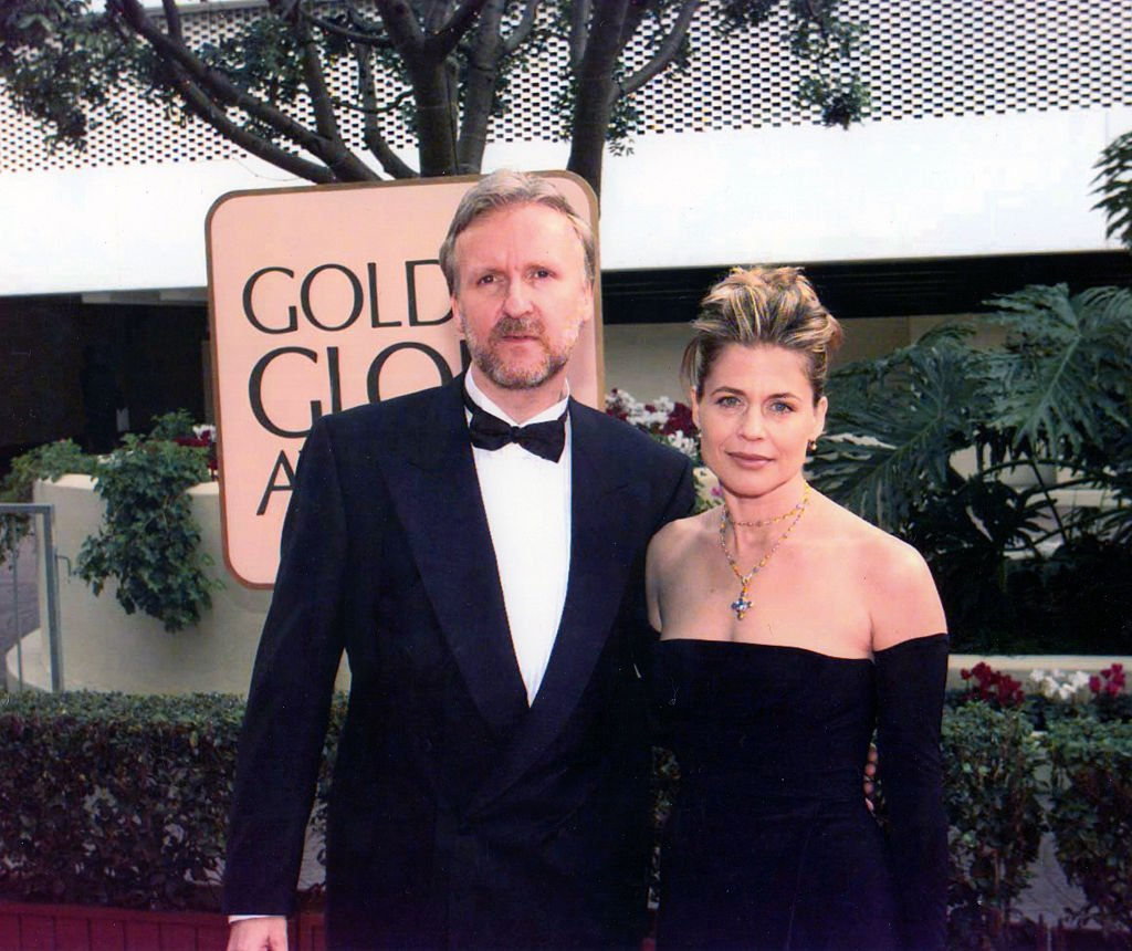 Image Credit: Getty Images / Portrait of married couple, director James Cameron and actress Linda Hamilton, as they pose together at the Beverly Hilton Hotel during the 55th Golden Globe Awards.