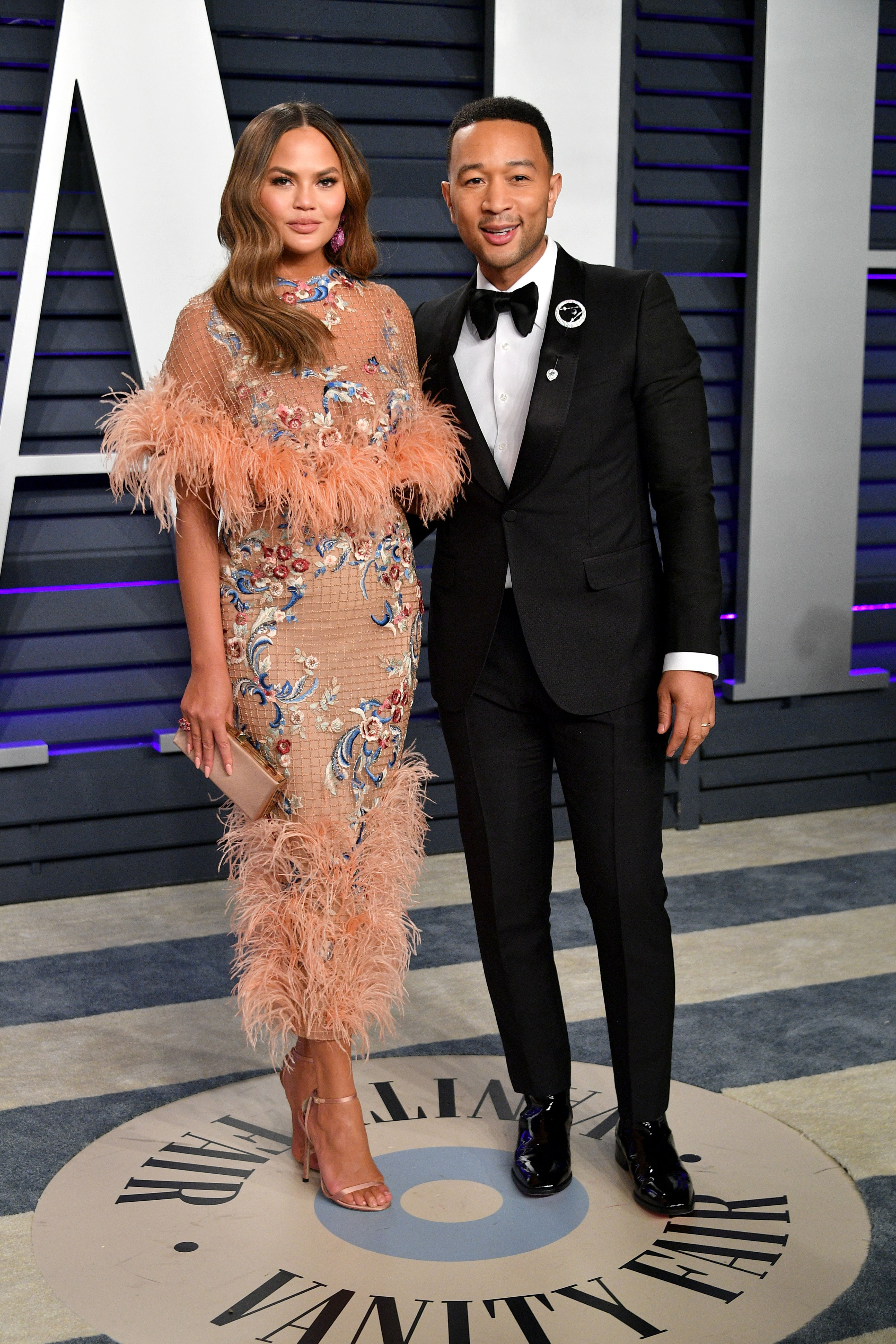 Chrissy Teigen and John Legend at the Vanity Fair Oscar Party / Getty Images