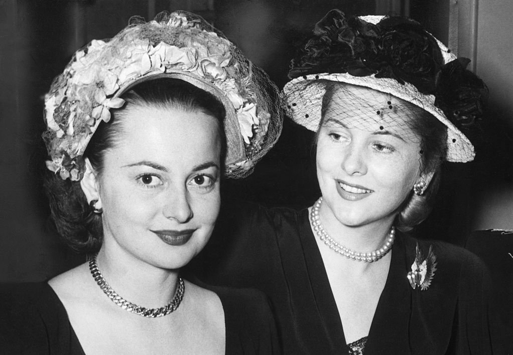 Image Credits: Getty Images /  Bettmann  | Olivia de Havilland and Joan Fontane