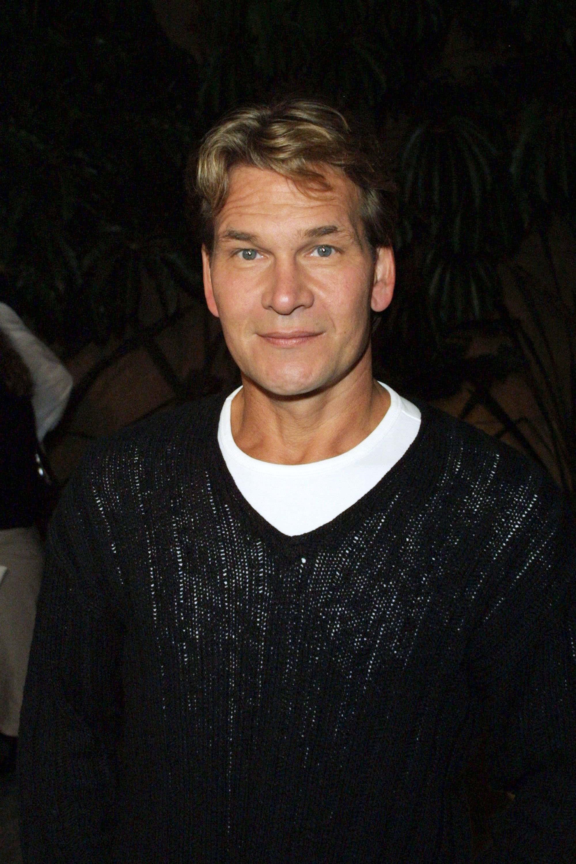 "Image Credits: Getty Images / Jason Kirk | Actor Patrick Swayze arrives at the premiere of ""Donnie Darko"" at the Egyptian Theatre October 22, 2001 in Hollywood, CA."