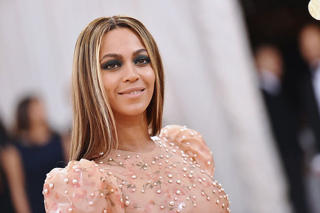 Image Credit: Getty Images / Singer and businesswoman, Beyonce poses for a picture at an event.