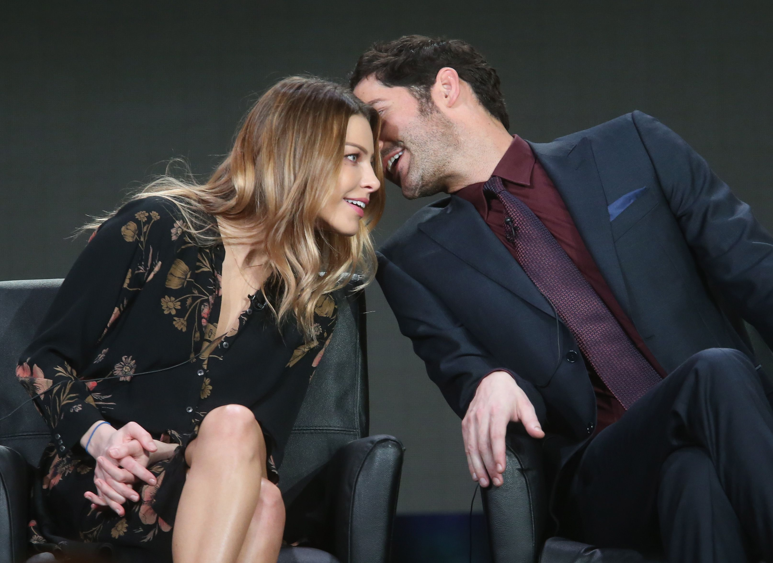 Tom Ellis and Lauren German are on great terms in real life / Getty Images