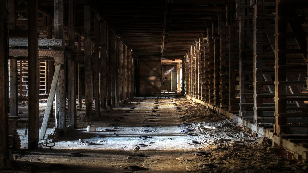 View from old, abandoned brick factory in Southern Finland. Urban exploration. | Shutterstock