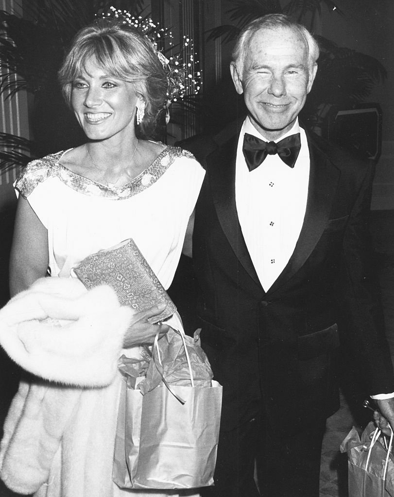 Image Credits: Getty Images / Kevin Winter | Television host Johnny Carson and his girlfriend Alex Maas attending the American Film Institute Awards at the Beverly Hilton Hotel, California, March 6th 1986.