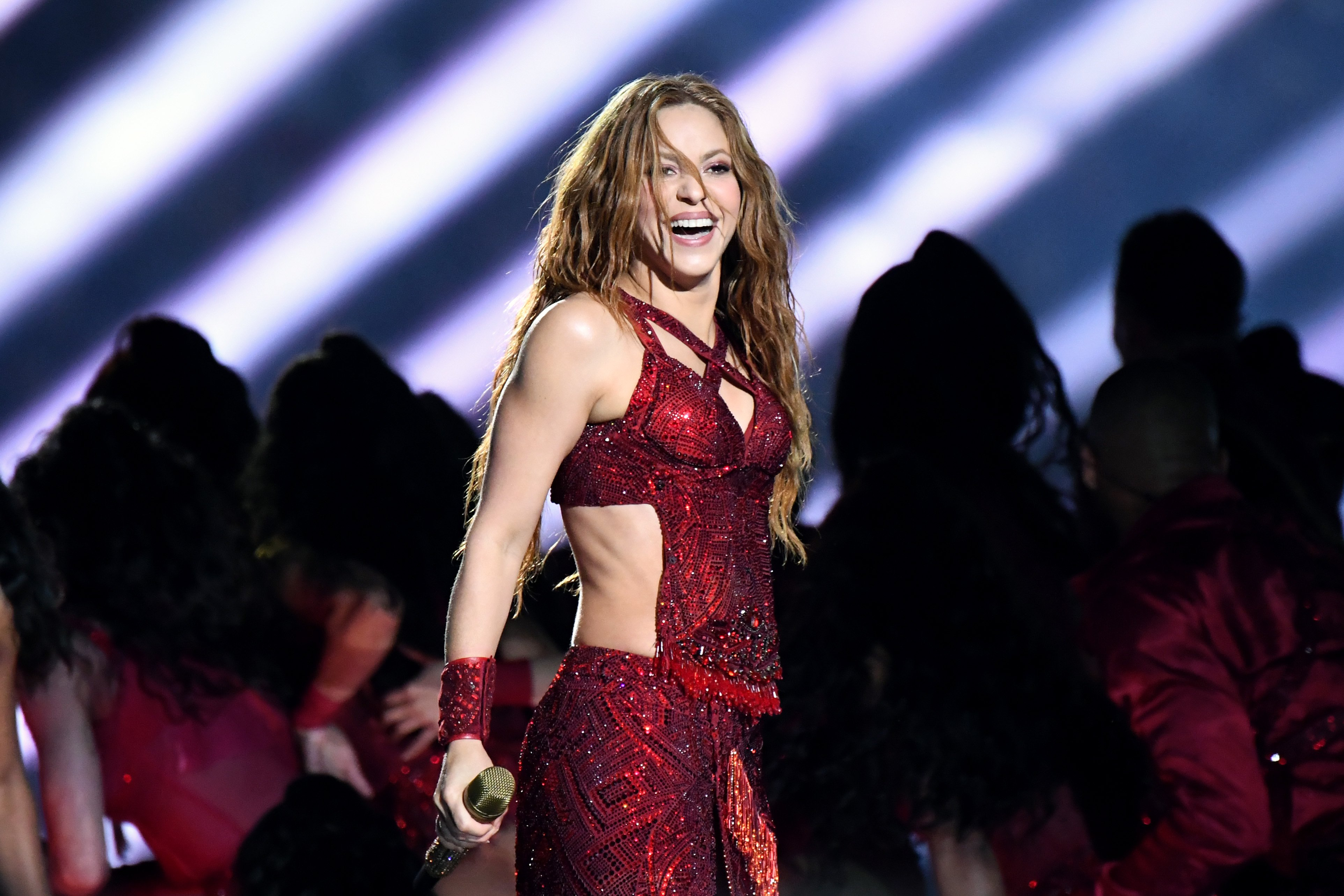 Image Credit: Getty Images / Shakira performing at the Super Bowl LIV Halftime Show.