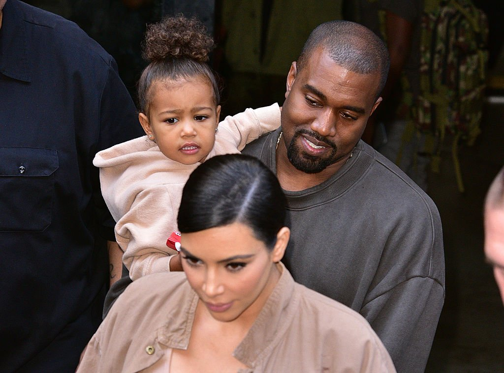 Image Credit: Getty Images / North West, Kanye West and Kim Kardashian leave Kanye West Yeezy Season 2 New York Fashion Week show at Skylight Modern on September 16, 2015 in New York City.