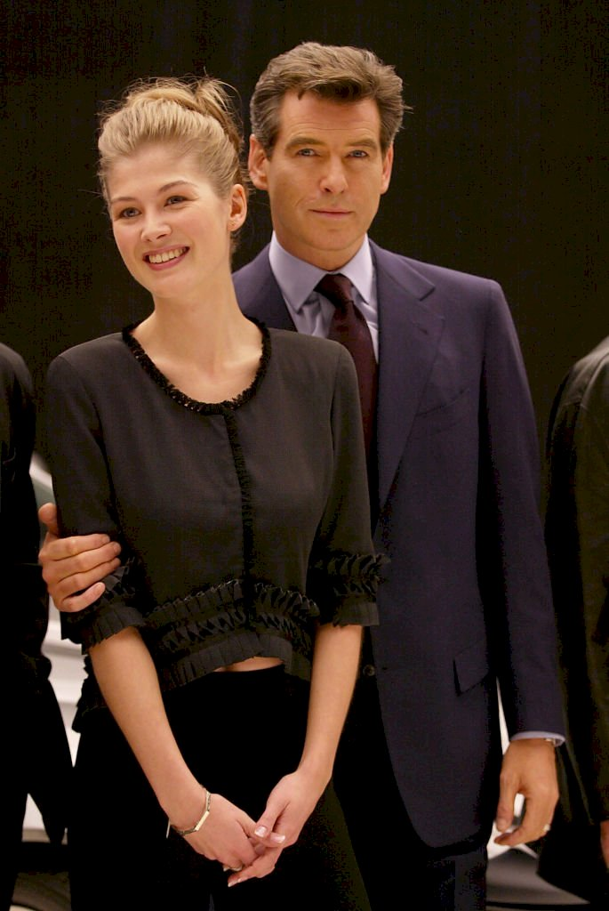 Image Credit: Getty Images / Rosamund Pike with her James Bond, Pierce Brosnan.