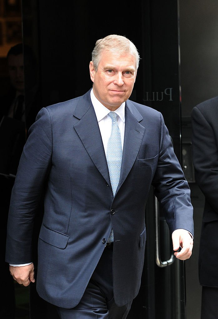 Image Source: Getty Images/ Prince Andrew walking in a suit