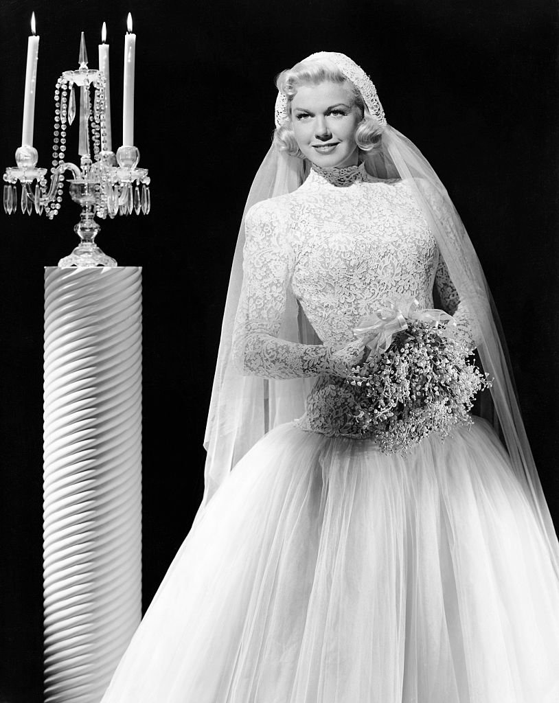 Image Credits: Getty Images / George Rinhart / Corbis | (Original Caption) W.B. star and radio lark of the Bob Hope show in a bride's outfit of lace and tulle.
