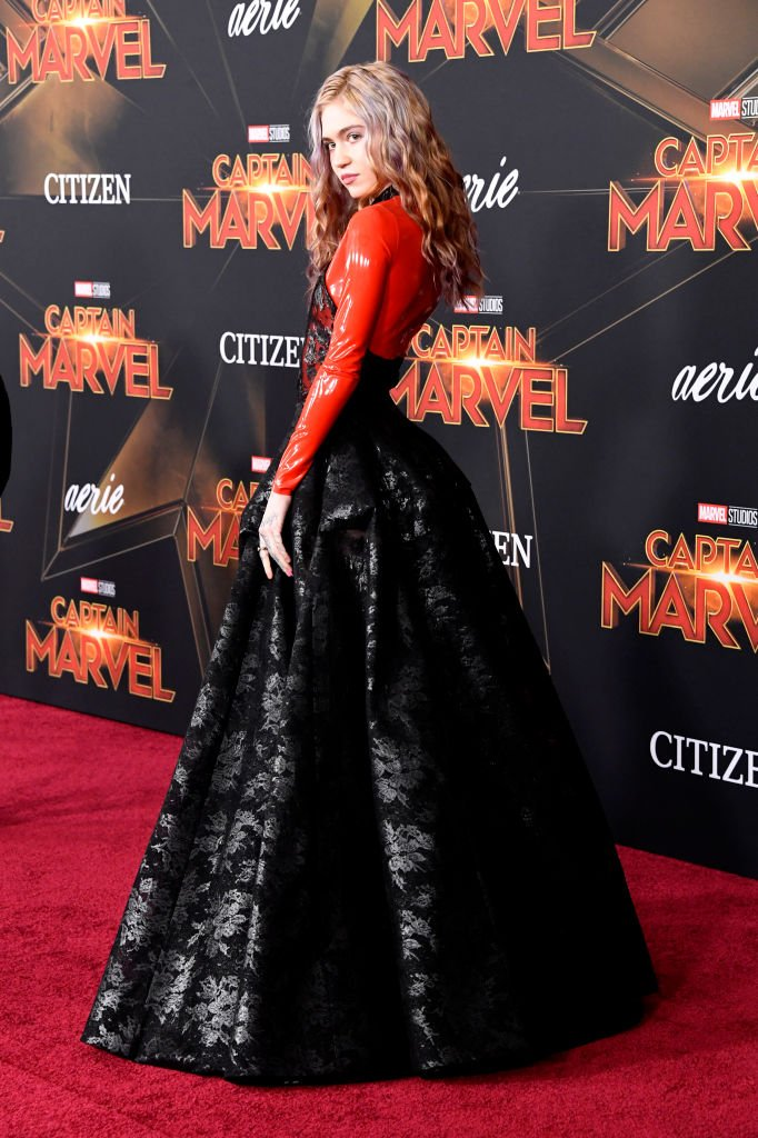 "Image Credit: Getty Images / Grimes attends the Marvel Studios ""Captain Marvel"" premiere on March 04, 2019 in Hollywood, California."