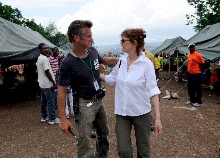 Sean Penn greets Susan Sarandon after a visit to a camp for internally displaced persons managed by Penn and his Jenkins-Penn Humanitarian Relief Organization in Port-Au Prince, Haiti. The group, Artists for Peace and Justice is working to rebuild Haiti�s education system on April 12, 2010 in Port-au-Prince, Haiti. (Photo by Kevork Djansezian/Getty Images for Artists For Peace And Justice)