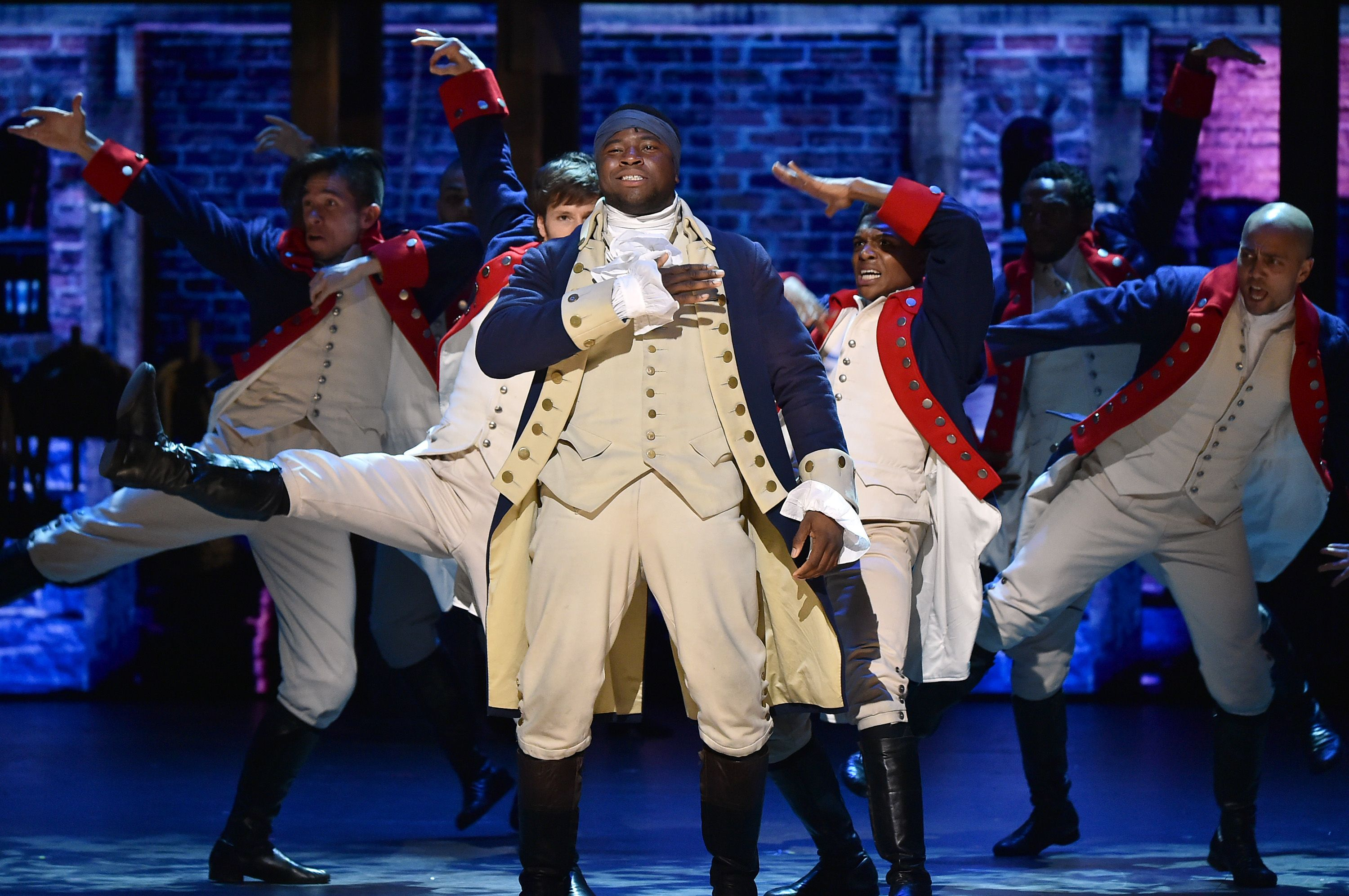Okieriete Onaodowan and the cast of 'Hamilton' perform onstage during the 70th Annual Tony Awards / Getty Images