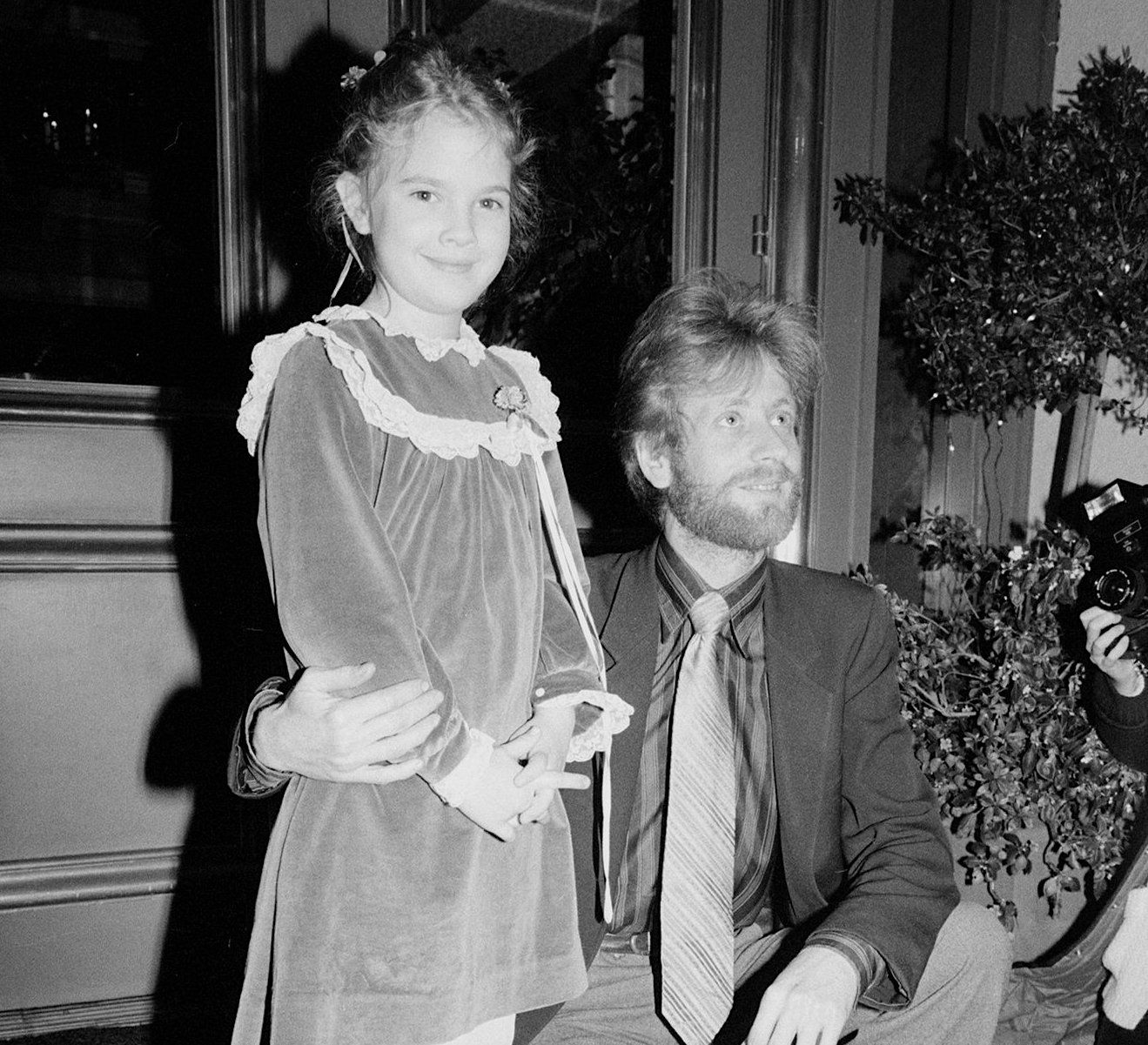 Image Credit: Getty Images/Drew Barrymore with her grandfather