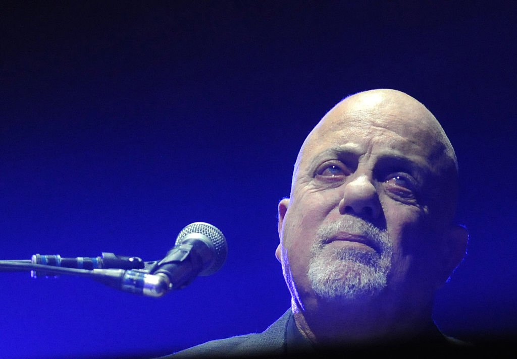 Image Credits: Getty Images / Paul Hennessy / NurPhoto | Billy Joel performs on stage at the Amway Center on January 11, 2019 in Orlando, Florida.