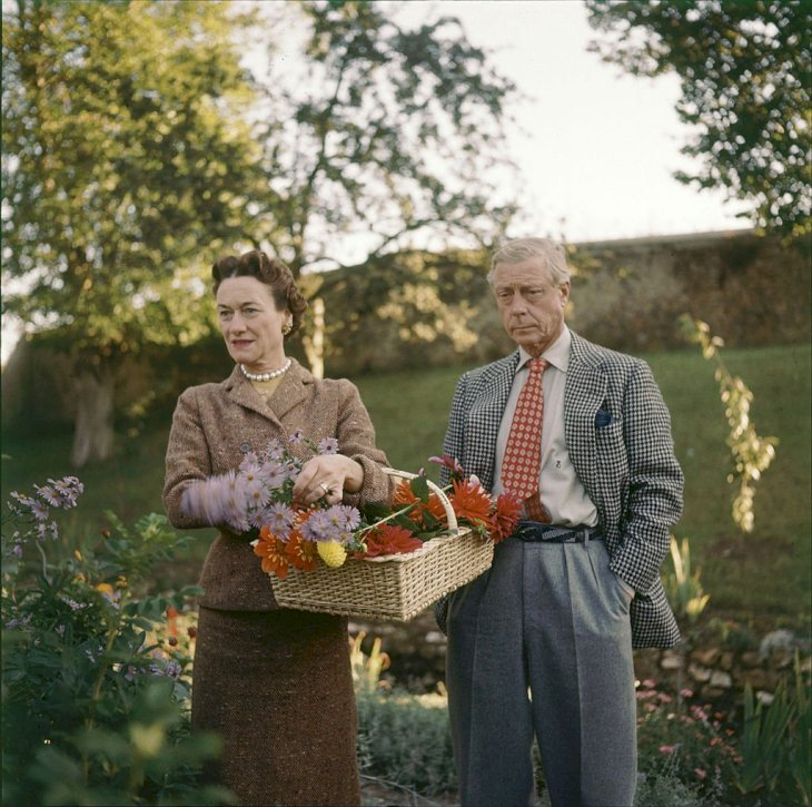 Image Credits: Getty Images / Frank Scherschel / The LIFE Picture Collection | The Duchess and Duke of Windsor pick flowers on the grounds of their home outside of Paris, France, 1955.