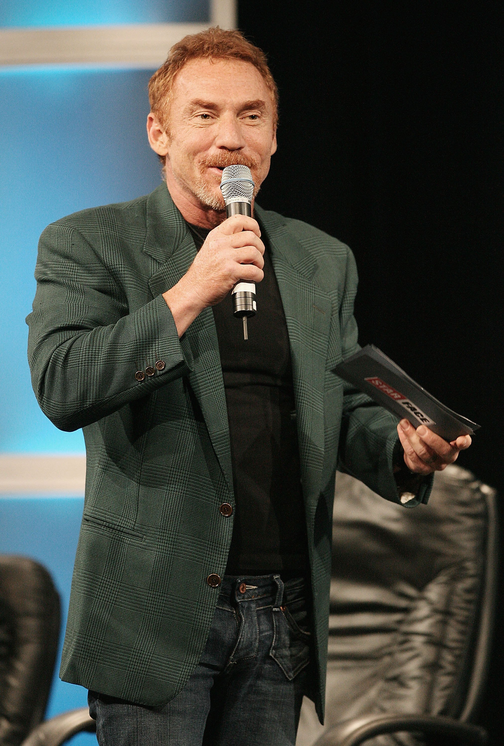 Image Source: Getty Images | Danny speaking at an event