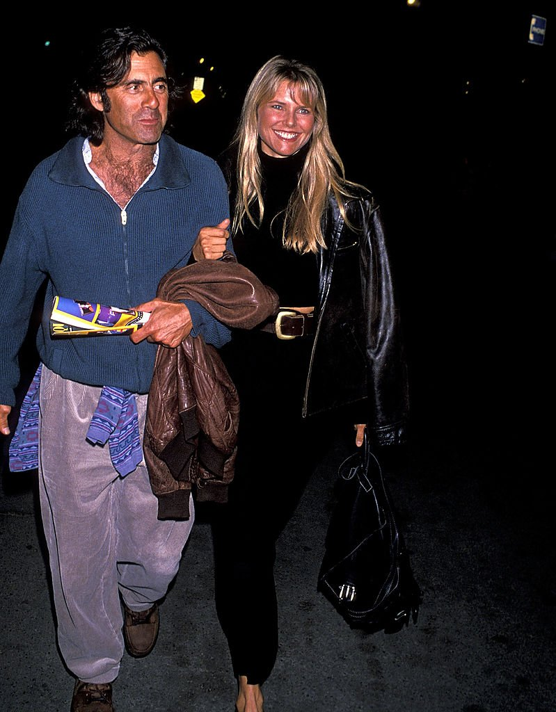 "Image Credits: Getty Images / Ron Galella, Ltd. / Ron Galella Collection | Model Christie Brinkley and fiance Ricky Taubman attend the Opening Night Performance of Cirque du Soleil's ""Alegria"" on October 6, 1994 at Santa Monica Pier in Santa Monica, California."