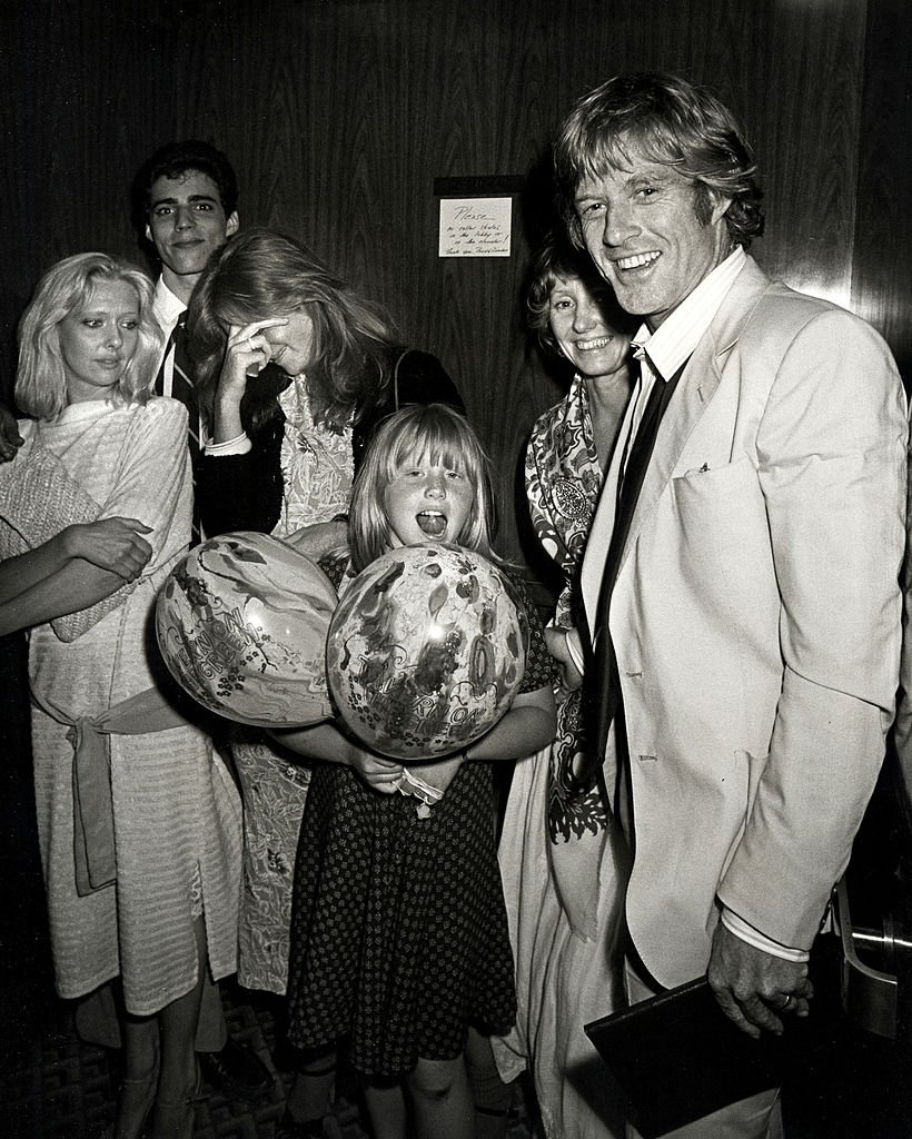 Image Credits: Getty Images / Ron Galella / Ron Galella Collection | Shauna Redford, Amy Redford, Lola Redford and Robert Redford.