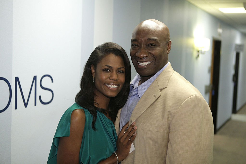 Image Credit: Getty Images / Omarosa Manigault-Stallworth and actor Michael Clarke Duncan backstage at The Tonight Show with Jay Leno on February 20, 2012
