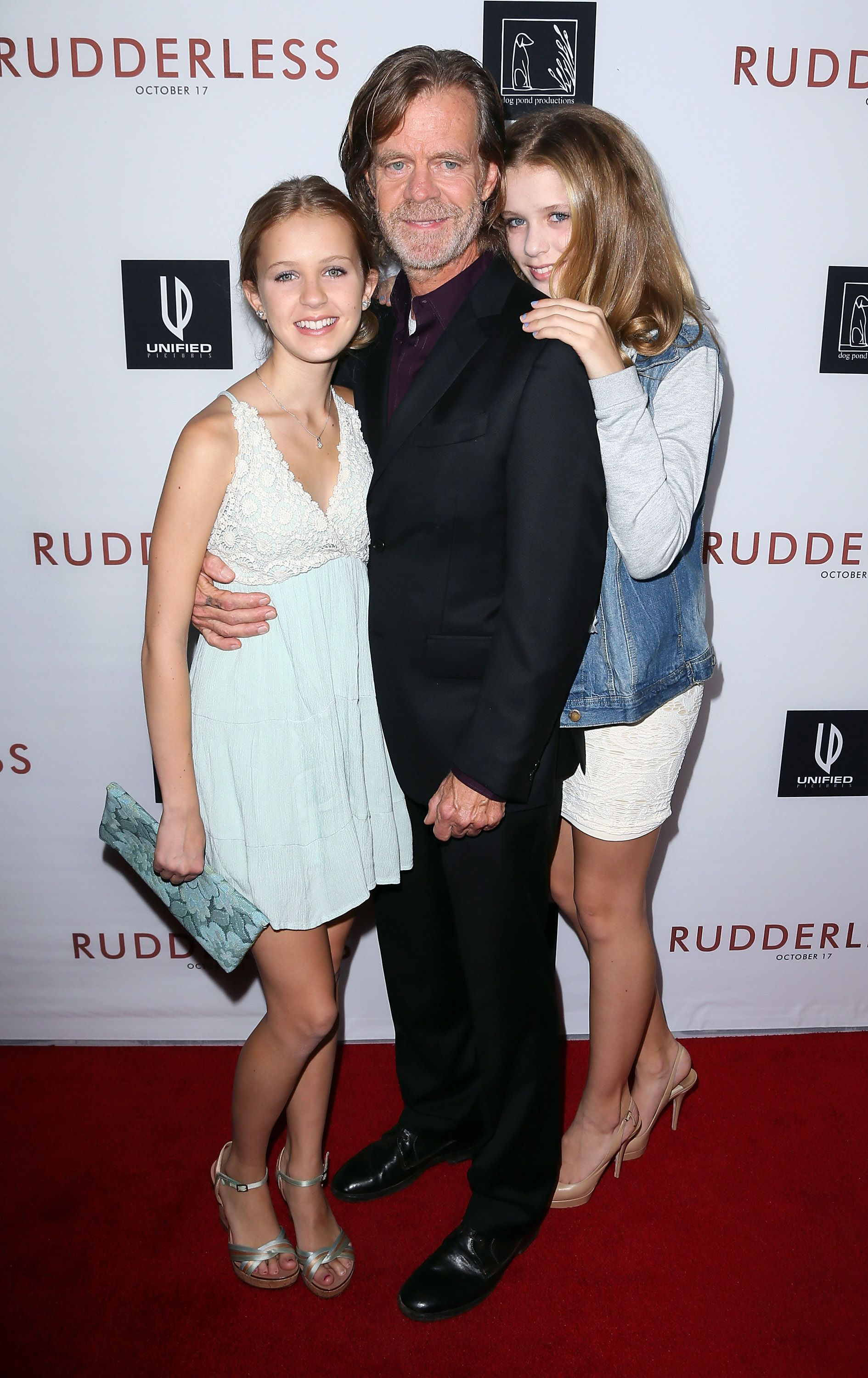 """William H. Macy and his daughters at a screening of """"Rudderless"""" in 2014 / Getty Images"""