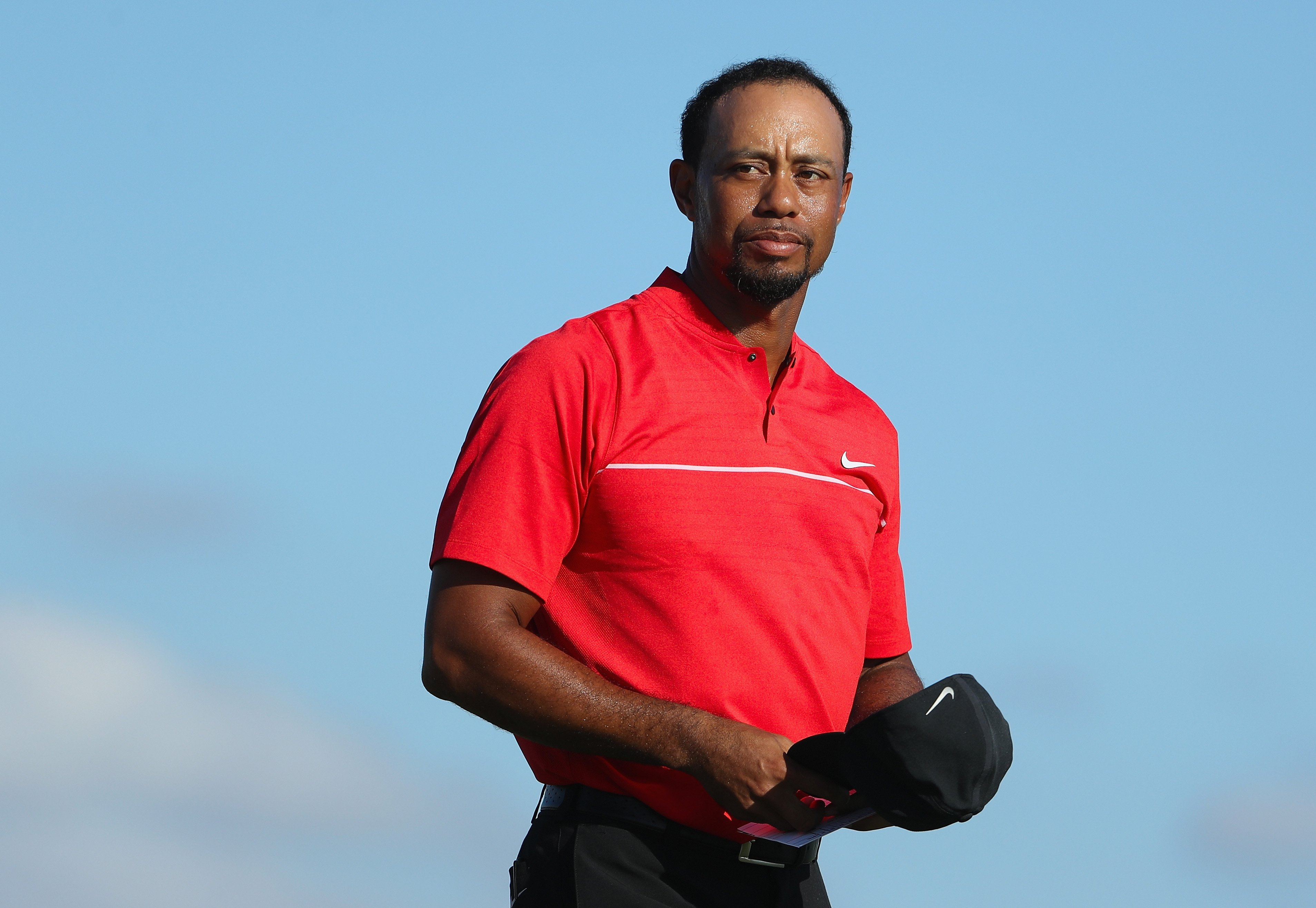 Image Credits: Getty Images / Christian Petersen | Tiger Woods of the United States looks on as he walks off the 18th hole during the final round of the Hero World Challenge at Albany, The Bahamas on December 4, 2016 in Nassau, Bahamas.