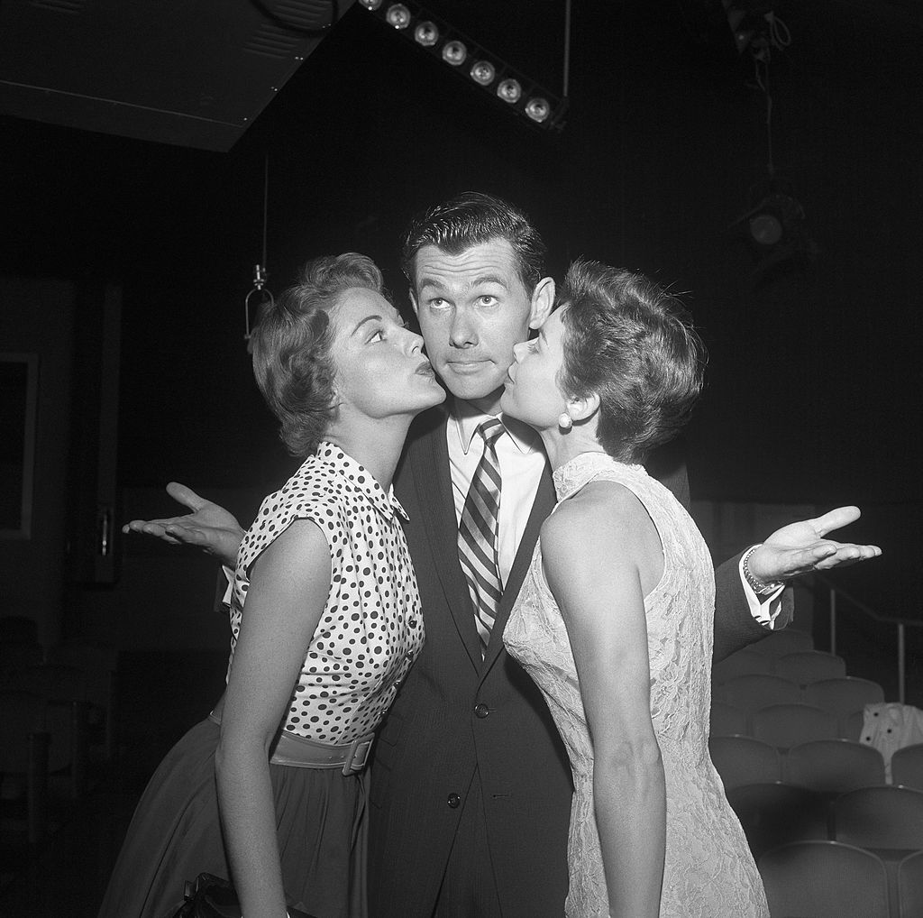 Image Credits: Getty Images / Michael Ochs Archives | Johnny Carson With Virginia Gibson left and wife Joan.