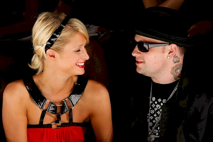 Image Credits: Getty Images / Michael Buckner | Socialite Paris Hilton and musician Benji Madden pose in the front row at the Nicholai By Nicky Hilton Fall 2008 fashion show during Mercedes-Benz Fashion Week held at Smashbox Studios on March 11, 2008 in Culver City, California.