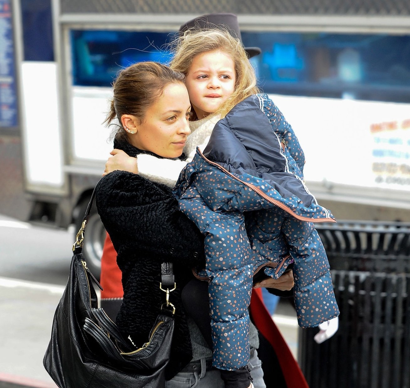 Image Credit: Getty Images/Nicole carrying her daughter