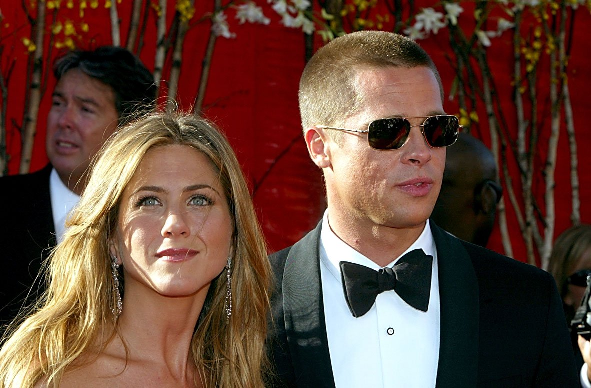 Image Credits: Getty Images / Kevin Winter | Actress Jennifer Aniston and Actor/husband Brad Pitt attend the 56th Annual Primetime Emmy Awards on September 19, 2004 at the Shrine Auditorium, in Los Angeles, California.