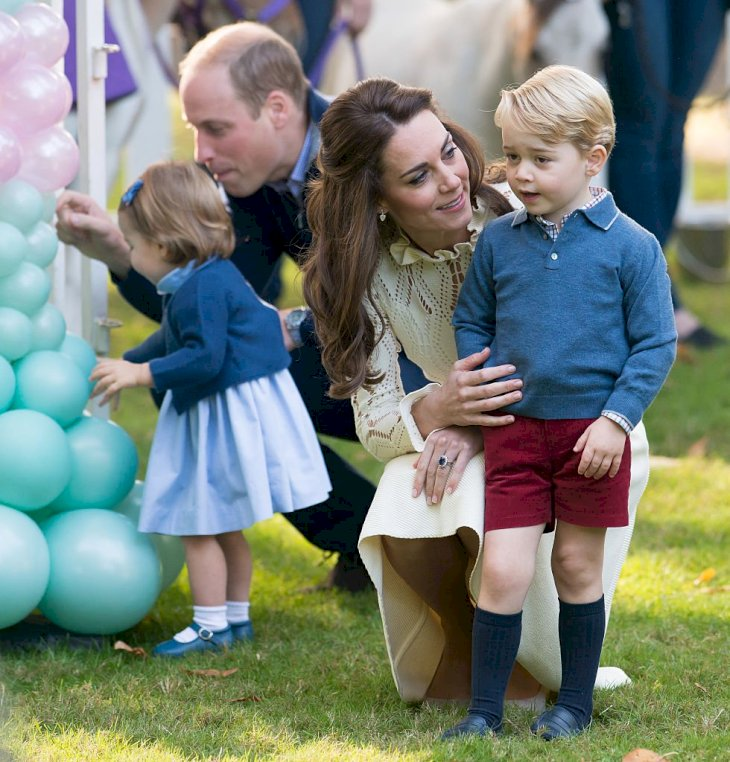 Image Credit: Getty Images / Prince William, Duke of Cambridge, Catherine, Duchess of Cambridge, Prince George of Cambridge and Princess Charlotte of Cambridge attend a children's party for Military families.