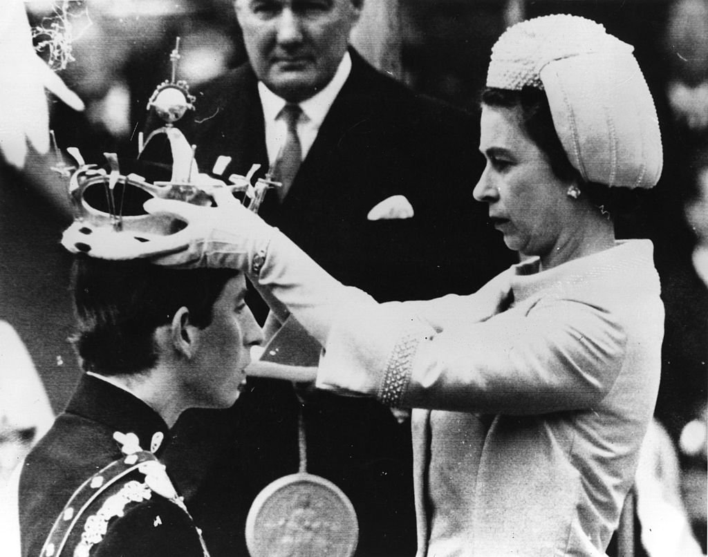 Image Credit: Getty Images / Prince Charles, Prince of Wales, Queen Elizabeth II during the Investiture of Prince Charles as Prince of Wales on July 1, 1969 at Caernafon Castle in Gwynedd, Wales.