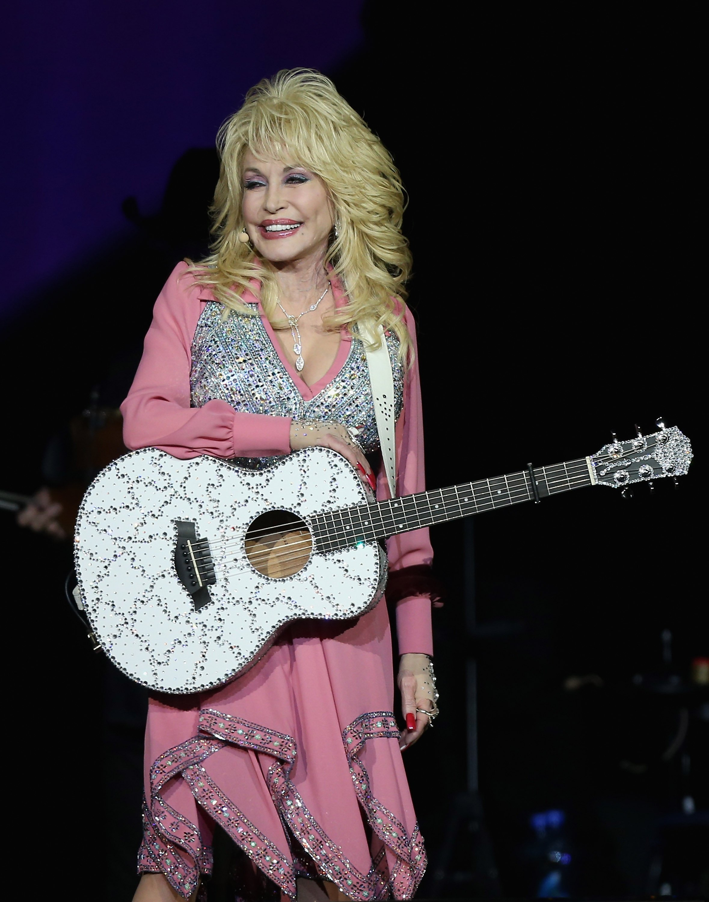 Dolly Parton performs live for fans at Vector Arena on February 7, 2014 | Image Source: Getty Images