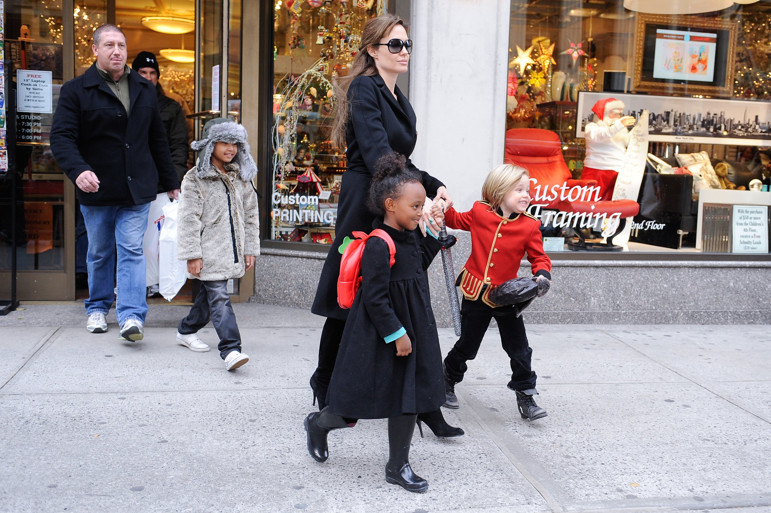Image Source: Getty Images/Angelina leaving a shop with her kids