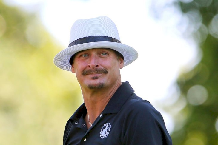 Image Credit: Getty Images/NurPhoto via Getty Images/Amy Lemus |Kid Rock follows during the celebrity shootoutof The Ally Challenge