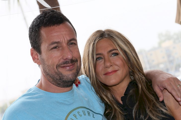Image Credit: Getty Images/David Livingston | Adam Sandler and Jennifer Aniston during a promotional event for their film, Murder Mystery