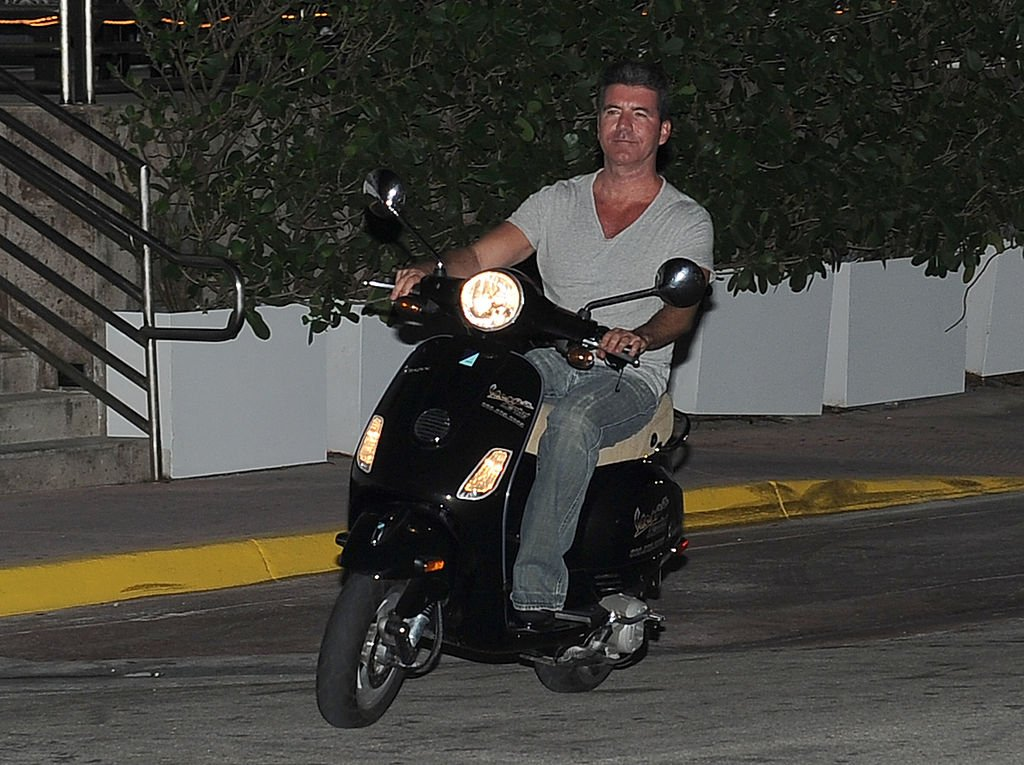 Image Credit: Getty Images / Simon Cowell is seen riding his scooter on March 04, 2014 in Miami, Florida.