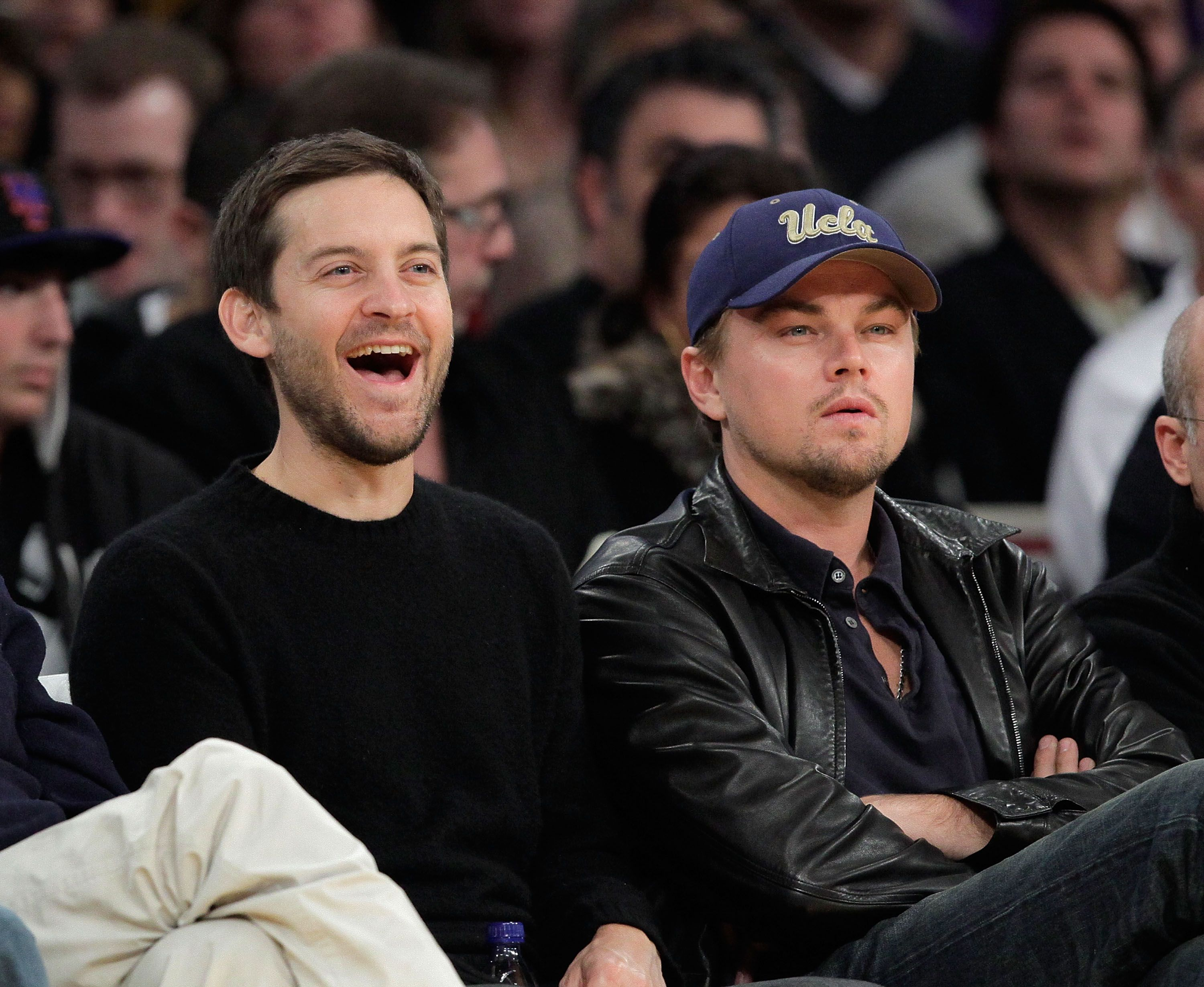 Tobey Maguire  and Leonardo DiCaprio  attend a game between the Oklahoma City Thunder and the Los Angeles Lakers / Getty Images