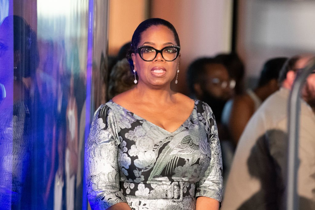 """Image Credit: Getty Images / Oprah Winfrey stands off stage in anticipation of her honor at """"Watching Oprah: The Oprah Winfrey Show And American Culture"""" Press Preview at National Museum Of African American History & Culture on June 7, 2018."""