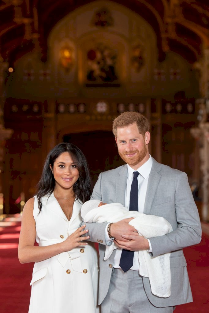 Image Credit: Getty Iamges/Dominic Lipinski - WPA Pool |  Prince Harry, Duke of Sussex and Meghan, Duchess of Sussex, pose with their newborn son Archie Harrison Mountbatten-Windsor