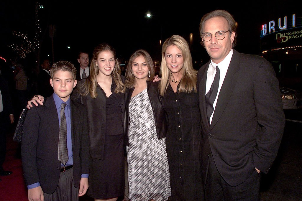 Image Credit: Getty Images / Kevin Costner and Christine Baumgartner with his children (L to R) Joe, Lilly and Annie at the premiere of 'Thirteen Days' at the Village Theater in Los Angeles.