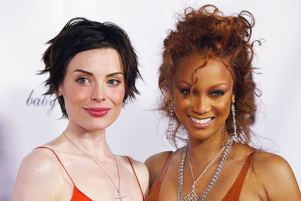 """Image Credit: Getty Images / Supermodel Tyra Banks (R) and winner of UPN'S """"America's Next Top Model"""" Yoanna House (L) attend the finale party held at the Key Club, March 23, 2004 in Hollywood."""