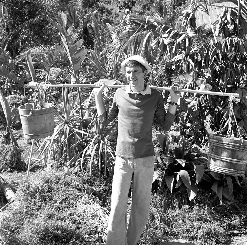 Image Credit: Getty Images / CBS television situation comedy program Gilligan's Island, episode 'Home Sweet Hut.' Filmed at the lagoon, CBS Studio Center, Studio City, CA. Image date, March 3, 1964. Original broadcast date October 3, 1964. Pictured is Bob Denver (as Gilligan).