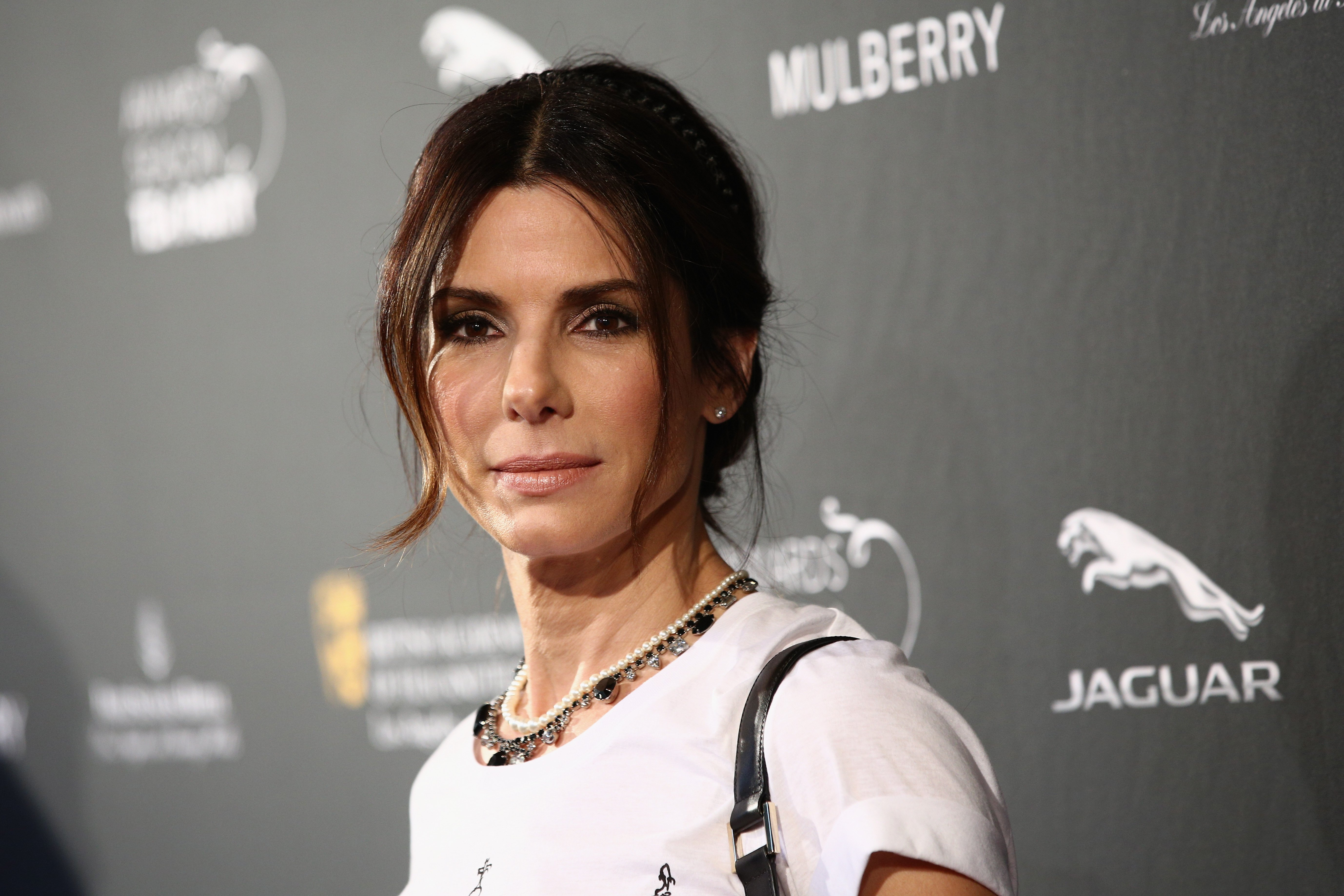 Image Credits: Getty Images / Imeh Akpanudosen | Actress Sandra Bullock attends the BAFTA LA 2014 Awards Season Tea Party at the Four Seasons Hotel Los Angeles at Beverly Hills on January 11, 2014 in Beverly Hills, California.