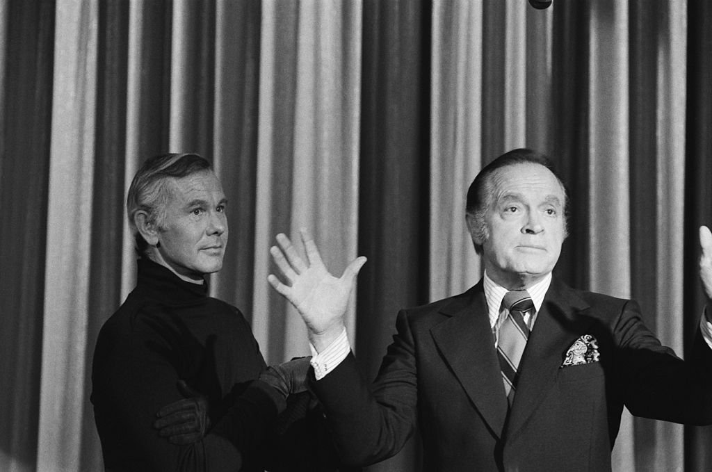 Image Credits: Getty Images / Frank Carroll / NBCU Photo Bank / NBCUniversal | Johnny Carson as The Masked Killer, Bob Hope.