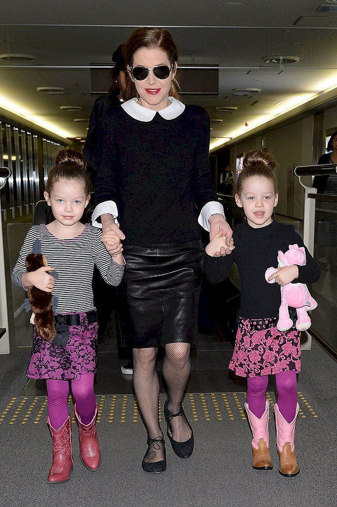 Image Credit: Getty Images / Singer Lisa Marie Presley with her twin daughters Harper Vivienne Ann and Finley Aaron Love arrive at Narita International Airport on April 5, 2014.