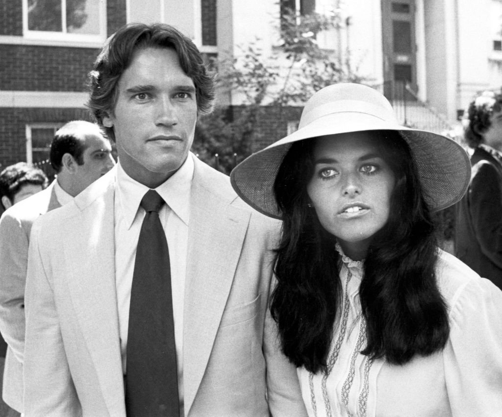 Image Credits: Getty Images / Ron Galella / Ron Galella Collection | Arnold Schwarzenegger and Maria Shriver attend the Courtney Kennedy and Jeff Ruhe Wedding at Holy Trinity Church, Washington D.C., 06/14/80.