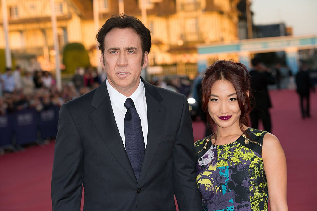 Image Source: Getty Images/Corbis via Getty Images/Stephane Cardinale | Cage and Kim in 2013